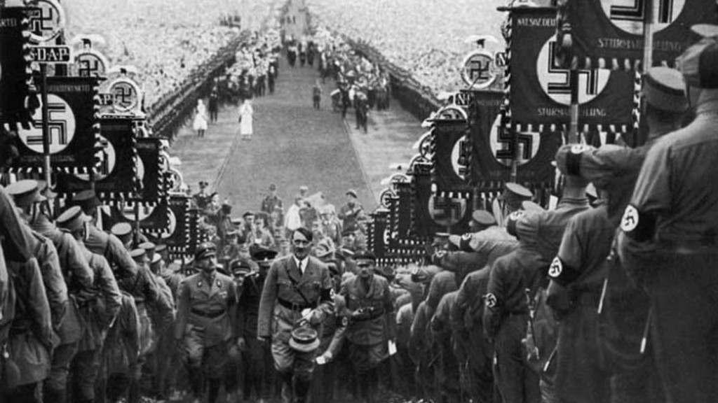hitler-walking-up-steps-at-nazi-rally