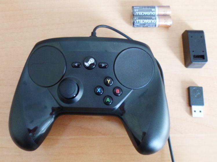 El Steam Controller y todos los elementos que lo acompañan para poder usarlo de forma inalámbrica