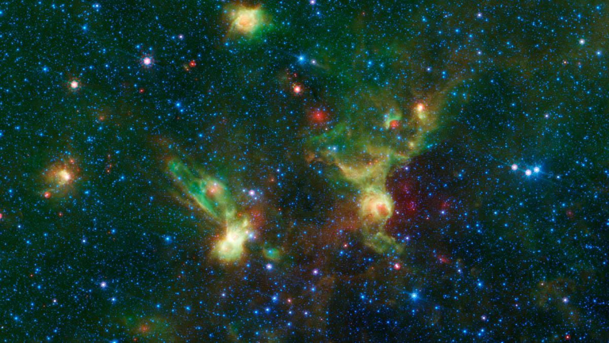 These nebulae seen by NASA's Spitzer Space Telescope, display two regions of star formation that are hidden behind a haze of dust when viewed in visible light, known officially y their catalog numbers, IRAS 19340+2016 and IRAS19343+2026.